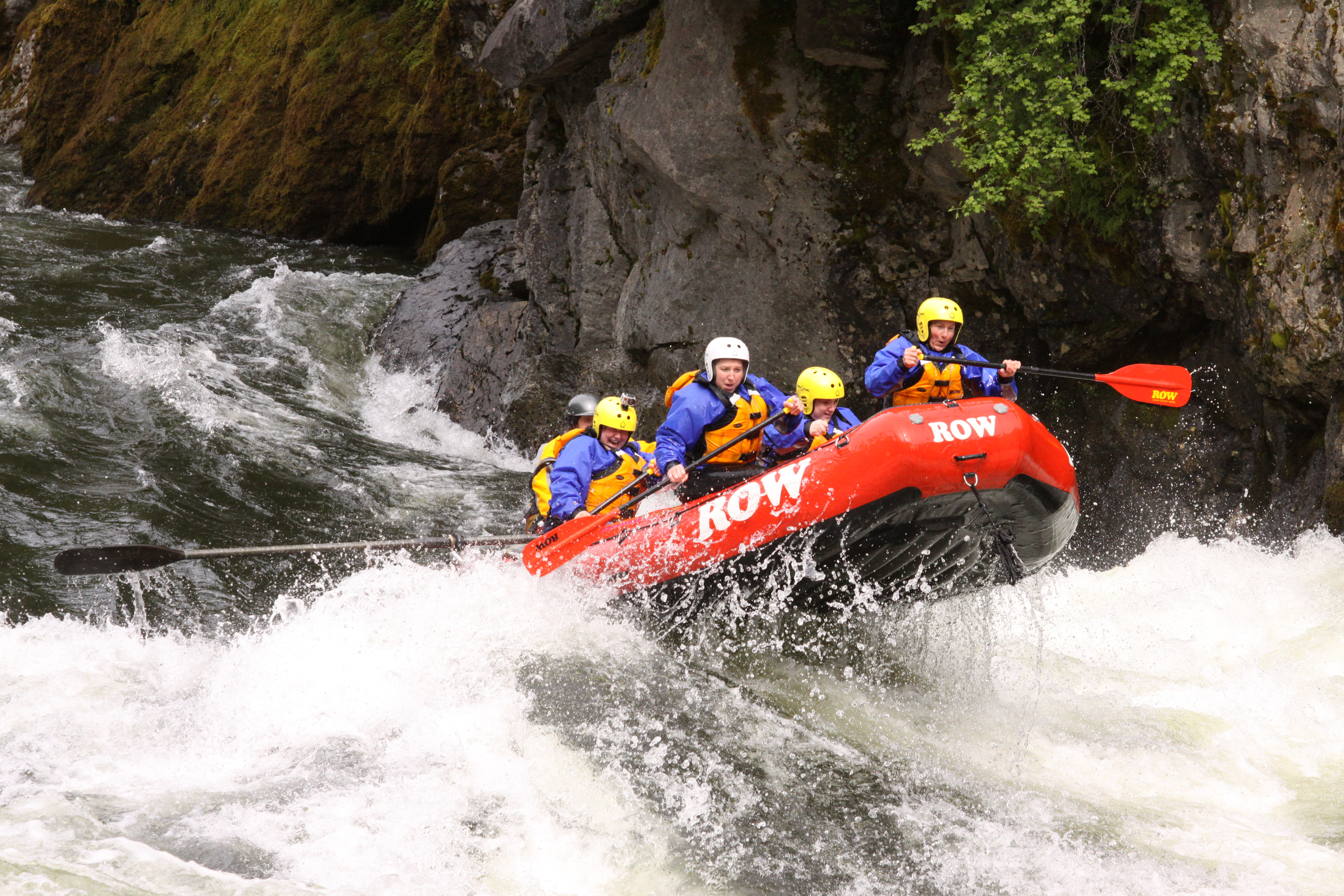 A ROW Adventures paddle crew pops through a rapids on the St. Joe River in North Idaho.